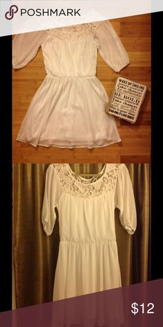 Free Spirited White Dress  Pure Hippiness dress with lace neckline... sheath cut, sits right above the knees, can be worn with a tan belt, cowgirl boots, or gladiator sandals. . Sleeves are 3/4ths and can be worn over or off the shoulder . Super Romantic, used, and well maintained. Dresses