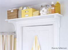 ideas to add storage for toiletries and towels in a small bathroom above a door