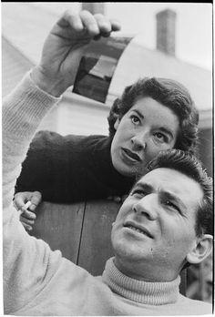 Leonard Bernstein [Leonard Bernstein and a woman looking at a negative.]