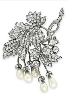 AN ANTIQUE PEARL AND DIAMOND BROOCH. Of foliate design, set with old mine-cut diamonds, suspending four natural pearls and one cultured pearl, mounted in silver-topped gold, circa 1860. #Antique #Pearl #brooch
