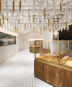 rolling pins hang from ceiling inside beijing bakery by B.L.U.E architecture studio Loved by www.6r.com.au