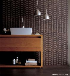 Inspiration from Bathrooms.com: Or... planning a streamlined scheme? Go for tiles with lots of detail, pattern or in unusual shapes (which makes the grout a highlight, too). #bathroom #tiles #wetrooms #designideas