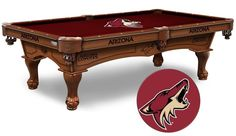 The NHL Arizona Coyotes Pool Table is available in an 8-foot length. The Wood cabinet has CNC and laser cut logos. Available in two finishes. Free installation. Visit SportsFansPlus.com for Details.