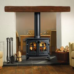 With the Yeoman Exe Double stove the stove doors front and back are designed to open into adjoining rooms with one central chimney. Each Yeoman double sided stove has a number of styling options to compliment your decor. The Exe double sided wood stove Brick Fireplace Log Burner, Brick Fireplace Makeover, Shiplap Fireplace, Small Fireplace, Modern Fireplace, Living Room With Fireplace, Fireplace Design, Fireplace Candles, Fireplace Brick
