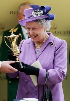 LOVELY IN LILAC:                                           The Duke of York presents Queen Elizabeth II with a trophy after her horse Estimate won the Gold Cup at Ascot.