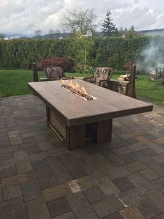 This is and has a 4 fire trough. The top is made of porcelain floor tiles that look like wood. - Fire Table Set - Ideas of Fire Table Set Fire Pit Patio Set, Outdoor Fire Pit Table, Fire Pit Sets, Deck Table, Fire Pit Table And Chairs, Gas Fire Pit Table, Diy Outdoor Table, Diy Dining Table, Outdoor Dining