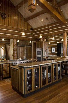 Kitchen facing living room, wide open. i would change a bit, closed cabinets, different lighting, no chinking style. Log Cabin Kitchens, Kitchen Living, Open Kitchen, Kitchen Island, Rustic Interiors, Log Homes, Rustic Cafe, Rustic Desk, Rustic Restaurant