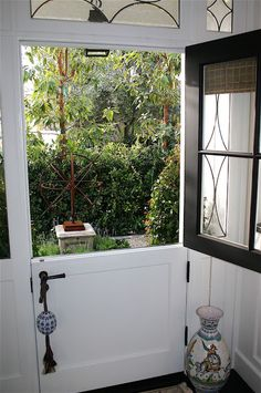 So lovely - charming dutch door....totally want one of these into the back yard :)
