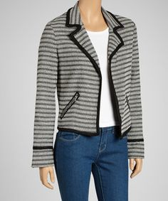 Any gal will look sharp as a tack when wearing this chic and on-trend blazer. Stripes and contrast trim exude preppy style, while sleek zipper pockets keep the silhouette modern.