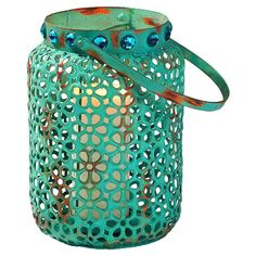 Metal candle lantern with a floral cut-out design.  Product: LanternConstruction Material: MetalColor: