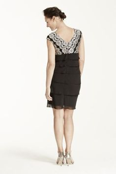You'll be the definition of classic elegance in this stunning lace and chiffon sheath dress!  Cap sleeve bodice fashioned from gorgeous floral lace features an alluring V-neckline.  Soft, chiffon tiered skirt adds tons and drama and movent to this simple silhouette.  Fully lined. Imported polyester. Back zipper. Professional spot clean.