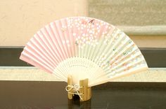 Authentic Japanese Hand Fan - Cherry Blossom (Sakura) #2!! $15.00  The Japanese hand fans are an important symbol in Japan . They were used by warriors as a form of weapon, actors and dancers for performances, and children as a toy. In Japan fans are given to others as present and serve as trays for holding gifts. You would also find them sometimes used in religious ceremonies and events.