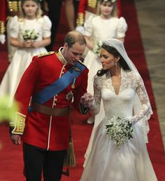 Britain's Prince William and his bride hold hands in Westminster Abbey