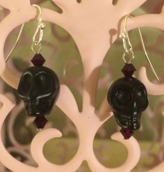Do you need a little darkness in your life? These fun and funky skull earrings could do just the trick. The black skulls are paired with