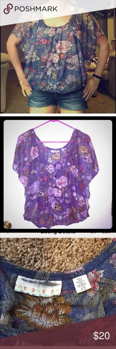 Kimchi Blue Blouse Floral country style Blouse has buttons on the front and open flaps in the back. There is a lining so you're not exposing skin. It has an elastic waist to make a flowy appearance. Great condition. Super cute top Kimchi Blue Tops Blouses