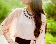 pink blouse & bold necklace
