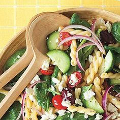Go Greek with your pasta salad by stirring in cucumber, tomato, olives, spinach, and feta, and tossing in a tangy vinaigrette.