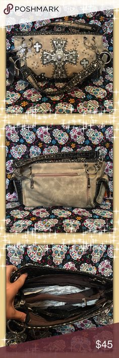 "🆕NWT🆕 Beige Western 'Cross' Handbag High quality faux pattern leather exterior. Fully lined fabric interior. Silver tone cross with rhinestone and metal stud accents. Chain linked shoulder carry strap. Rear exterior zip compartment and phone holder. Two exterior side magnetic flap close compartments. Zip close top with magnetic buckle clasp. Spacious interior with two zip compartments. Dimensions: 12.75""L x 8""H x 4.5""W Bags Shoulder Bags"