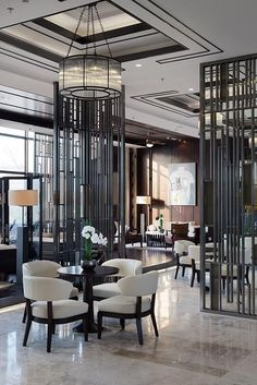 """""""The hotel industry leads the way in modern interior design trends. Key design elements: artistic lighting. Creating elaborate walls rather than decorating with art, the creative use of shape and contrasting walls. """" Tanna Espy Miller, lead designer DesignNashville.com"""