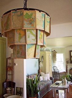 I love this.  Now thinking of how I can find a fixture I could do something similar with.  If I ever get my little office/artist studio one day would love to do something similar maybe with photos that inspire me, bits of old textiles, pieces of broken costume jewelry attatched or hanging down.  Would be my inspiration chandelier instead of inspiration board :)