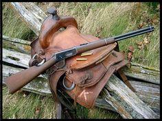 Winchester lever action rifle on saddle. Winchester is the standard for lever action rifles. lever action gun and saddle. Winchester Lever Action, Winchester 1894, Winchester Rifle, Henry Rifles, Westerns, Saddle Ring, Cowboy Action Shooting, Lever Action Rifles, Souvenir