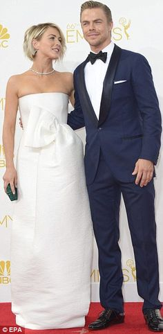 All white on the night: Julianne Hough sported a DSquared dress, Casedei shoes, Swarovski clutch, and Chopard jewels as she arrived with her dancer brother Derek