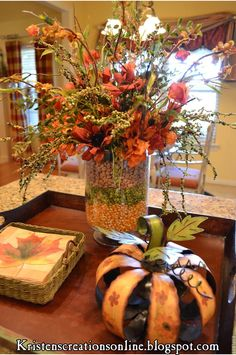 Fall arrangement made in a vase with layered corn,peas and beans. Everything is poked through the middle of the layers. fall-and-halloween-ideas