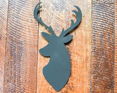 Metal, plasma cut, deer silhouette, powder-coated gray to be hung indoors or outdoors.