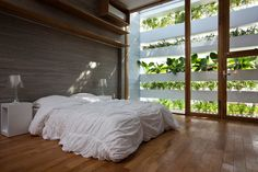 Bedroom with green outlook at Stacking Green in Ho Chi Minh City, Vietnam by Vo Trong Nghia Architects