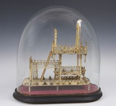 Early nineteenth century Napoleonic prisoner of war work carved bone guillotine under glass dome with two decks edged with gates and fretwork side panels with carved Napoleonic soldiers head finials and thirty cannons with ladder leading to the top execution deck with bench and guillotine, 31cm high, 30cm wide Glass Globe, Glass Domes, The Bell Jar, Bell Jars, Toy Theatre, Prisoners Of War, Objet D'art, Another World, Memento Mori