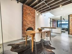 Stalking a loft 1-kitchen opens to a covered patio that is also where you park your car. What?!