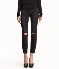 Low-rise, slim-fit, ankle-length jeans in washed stretch denim with ultra-slim legs. Front and back pockets, heavily distressed details at knees, and raw, frayed hems.
