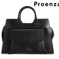 Proenza Schouler PS13 Made in Italy. Black grained leather trapezoidal top handle with two way zip closure and zipper on back. Envelope pocket on front. Linen lined interior w leather trimmed zipper pocket and two slip pockets. Detachable shoulder strap. Proenza Schouler Bags
