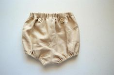 Gender neutral handmade linen bloomer shorts for infant or toddler. 100% linen. Elastic at waist and legs with tab details. Vintage buttons. French seams throughout. #linenbloomers #linenbabybloomers #linenbabyclothes #linentoddlerclothes #toddlerlinen #babylinen #vintageinspired #handmadelinenclothes #handmadelinenclothing #handmadechildrens