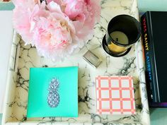 A decorative glass tray featuring a hand-painted pineapple illustration, finished with an 18kt gold edge detail. London-based artist, Melissa LaFave uses the traditional decoupage method to merge contemporary design with a classic artistic technique. Looks great on a coffee table, dressing table, desk or wall.