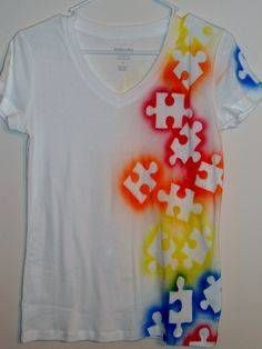 Puzzle shirt- spray paint (fabric paint) over large puzzle pieces.  What a cool idea for autism awareness!