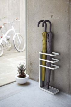 Interior Design Idea - What To Include When Creating The Ultimate Entryway // Umbrella Stand - Rather than hanging your umbrella on a hook on the wall, where the water trickles down the wall, or on the floor where you'll have a puddle of water, add a simple umbrella stand to your entryway.