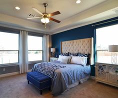 Add deep blue pillows, some white pillows, and a coordinating patterned throw to your bed.