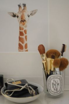 using empty candle jars as makeup brush holders!