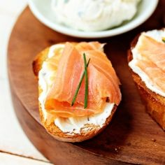 A creamy goat cheese spread is served on toasted baguette and topped with smoked salmon to create a simple bruschetta.
