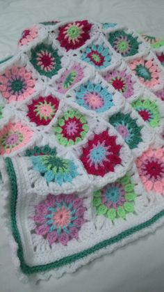 This is a pram blanket made using a flower pattern by Sue Pinner.  Colours used are Stylecraft clematis, spring green, sherbet, fuschia purple, sage, candyfloss and white