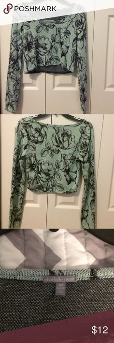 Floral Crop Top Fairly thick and knit material, never worn, for a medium fits quite small. Charlotte Russe Tops Crop Tops