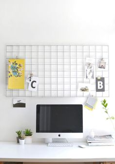 PROBLEM: NOT ENOUGH DESK (OR COUNTER) SPACE  Blogger Caroline Burke's repurposed metal mesh wall hanger could work equally well in a home office (one corner of your kitchen) or as an impromptu prep station (the other corner of your kitchen.)