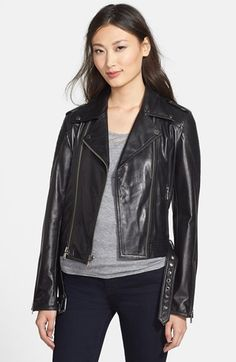 Free shipping and returns on Nicole Miller Trapunto Stitch Lambskin Leather Moto Jacket at Nordstrom.com. Trapunto-stitched panels add cool textural contrast for a slick moto jacket crafted from supple lambskin leather. The classic style is detailed with parallel front zips and an adjustable belt.