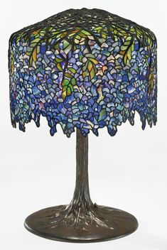 """Tiffany Studios """"WISTERIA"""" TABLE LAMP mounting post on underside of shade crown impressed 25525 1 top of base column impressed 1 22525 base plate impressed TIFFANY STUDIOS/NEW YORK/22525/1 with the Tiffany Glass and Decorating Company monogram leaded glass and patinated bronze"""