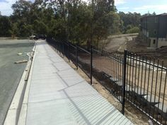 Security fencing is built to keep people both in and out of an area. Security fencing can be built with a number of materials to suit your desired style. Security Fencing, Fence, Sidewalk, Steel, Building, Outdoor Decor, Top, Side Walkway, Buildings