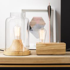 The Beacon Lighting Liam 1 light table lamp in Ash wood with clear jar shaped glass is perfect for a buffet or entry table, nestled into a bookcase or shelving or placed high on a shelf as a night light.