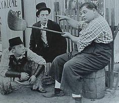 "Roscoe Arbuckle, Buster Keaton, and Al St. John in ""Out West"" (1918)"
