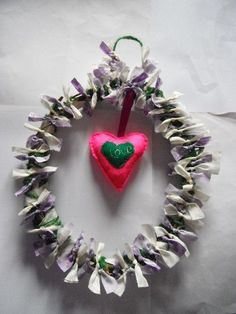 https://www.facebook.com/photo.php?fbid=432083853522989=a.432083666856341.102982.416111631786878=1    Wreath in lilac and pale yellow with pink heart with love on heart.Handmade from garden wood