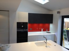Red glass splashback on ALNO kitchen with Corian worktops & Miele appliances. By Phil Harflett. Corian Worktops, Splashback, Alno Kitchen, Stylish Kitchen, Red Glass, Sink, Appliances, Home Decor, Sink Tops